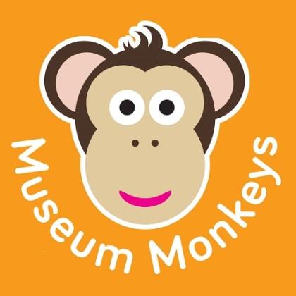 Cartoon monkey face on orange background