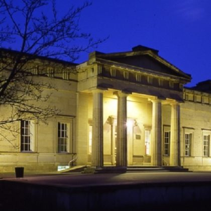 Facade of Yorkshire Museum lit up at night