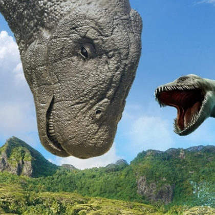 Two dinosaur heads against a landscape