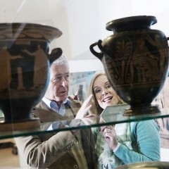 Older man and woman look at a Roman vase on a glass shelf at the Yorkshire Museum
