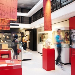 Red cases with glass tops house Roman artefacts in exhibition space at the Yorkshire Museum
