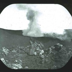 A woman stands near the erupting Vesuvius