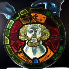 Multi-coloured stained glass depicting a king