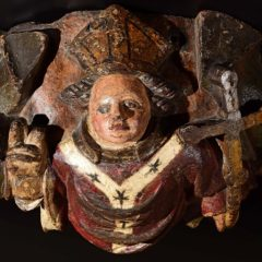 Wooden painted boss depicting religious figure