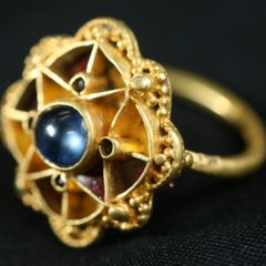 Decorative gold ring with blue central stone