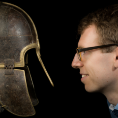 A man smiling at the historical York Helmet