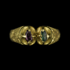 Fulford ring, a medieval golden ring with two gems in separate inserts, one purple and one green.