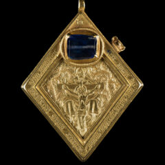 Middleham Jewel, a gold diamond-shaped pendent with blue sapphire inset above a carved scene depicting the crucifixion of Christ.
